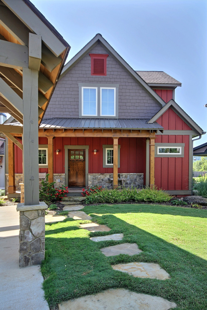 Inspiration for a mid-sized farmhouse red two-story mixed siding gable roof remodel in Atlanta with a shingle roof