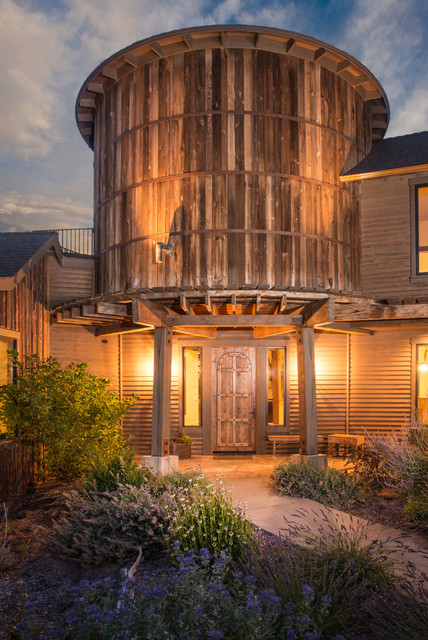Water tower inspired home inside front gate at dusk 2 for International decor gates