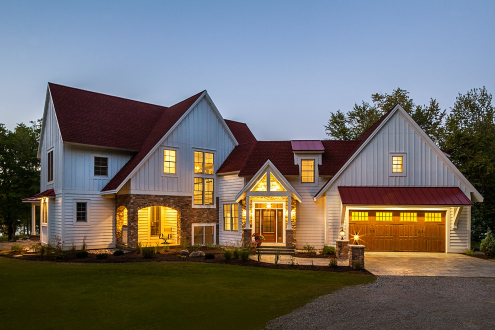 Mid-sized country white three-story gable roof idea in Grand Rapids