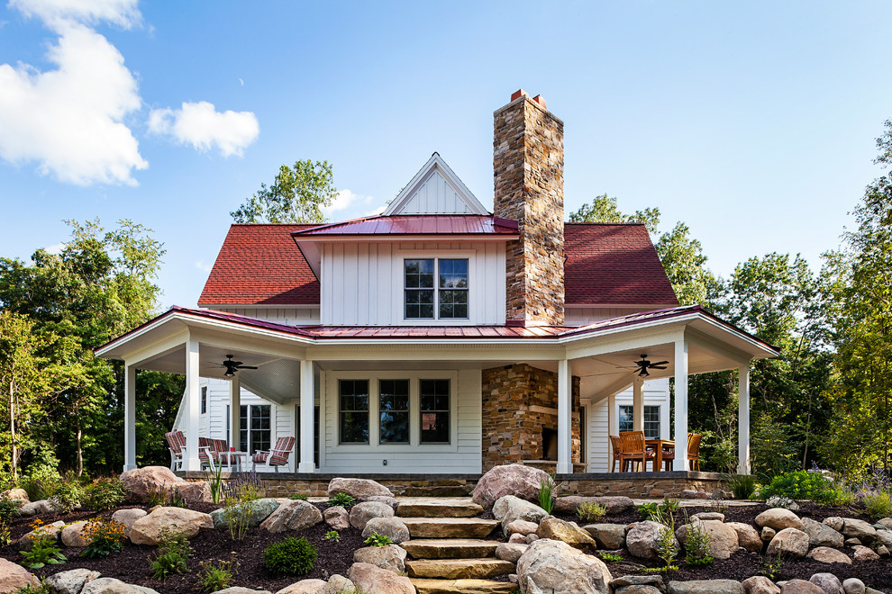 Inspiration for a mid-sized country white three-story gable roof remodel in Grand Rapids