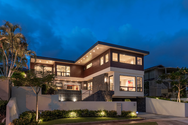 Inspiration for a large modern brown two-story mixed siding exterior home remodel in Hawaii
