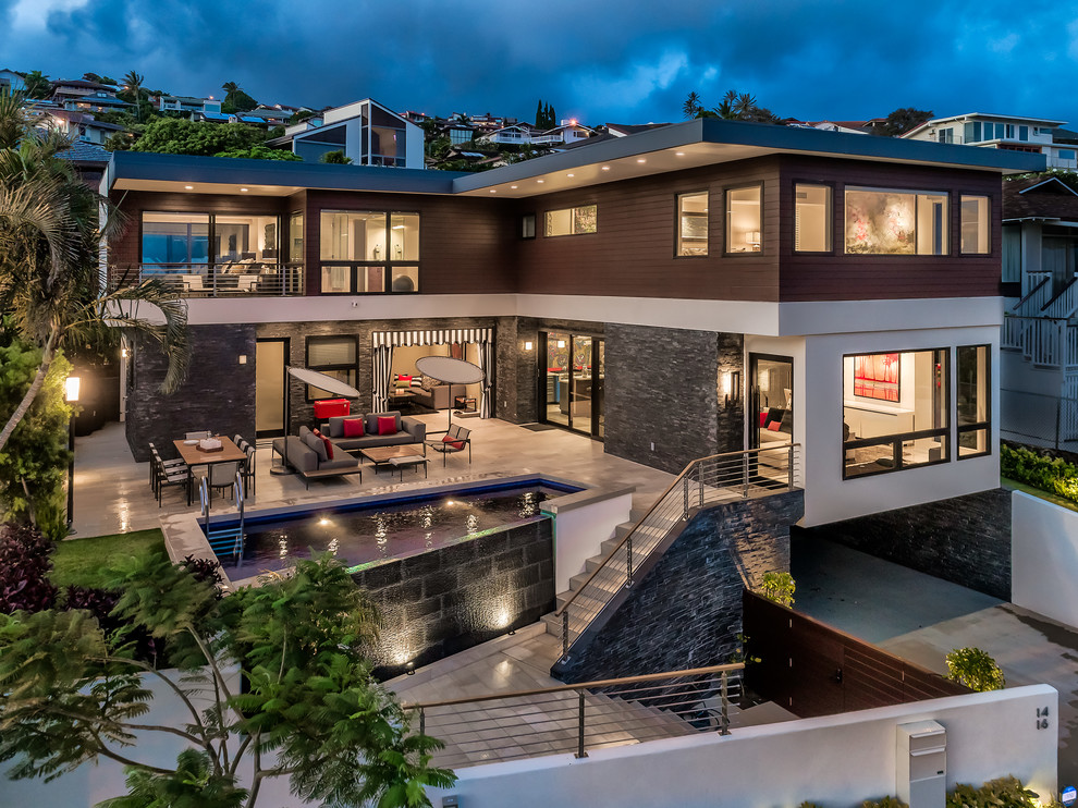 Large modern brown two-story mixed siding exterior home idea in Hawaii