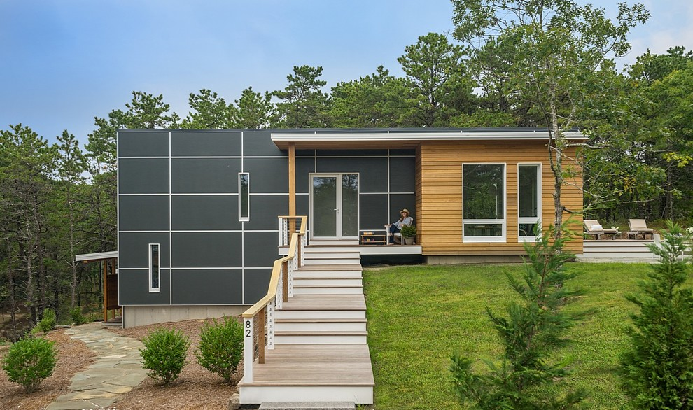 Example of a small trendy black two-story mixed siding exterior home design in Boston