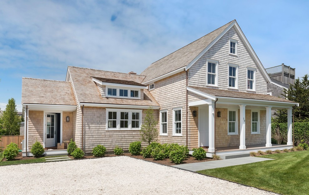 Large beach style beige two-story wood exterior home photo in Providence with a shingle roof