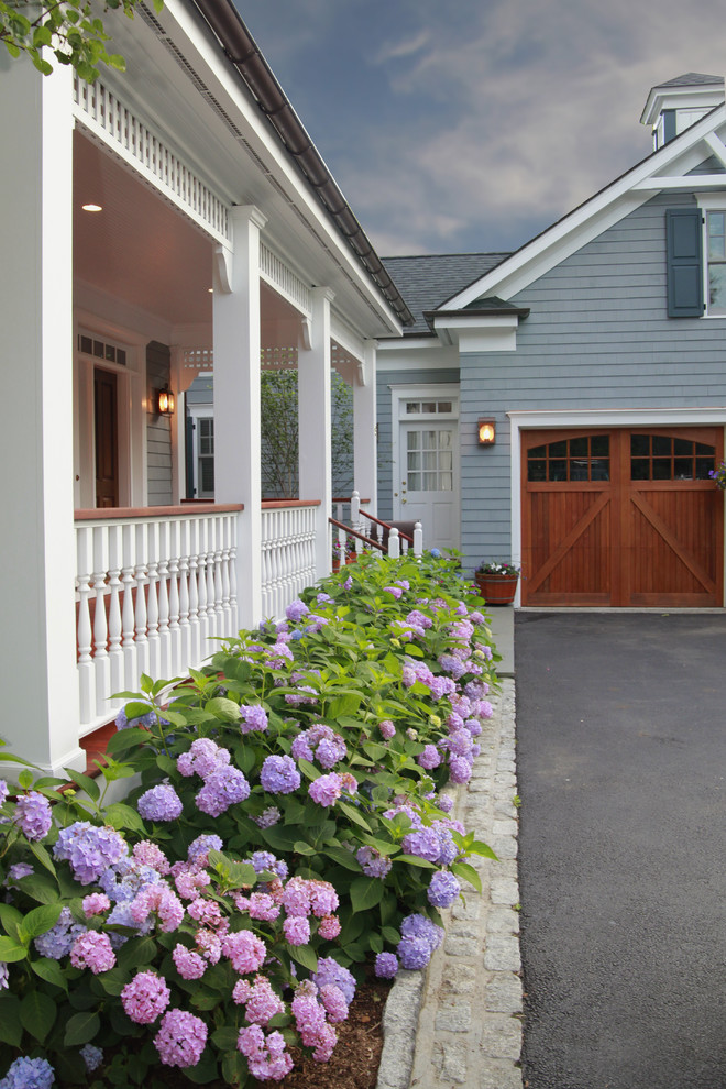 Example of a large classic blue wood exterior home design in New York