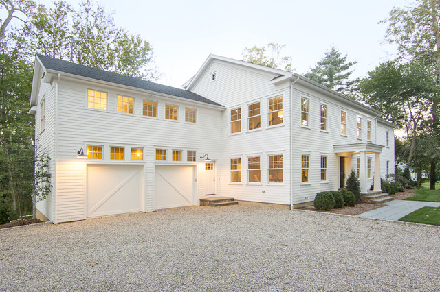 Westport farmhouse for the modern traditionalist for Farmhouse garage doors