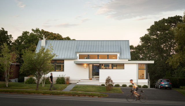 Inspiration for a contemporary white one-story exterior home remodel in Boston with a metal roof