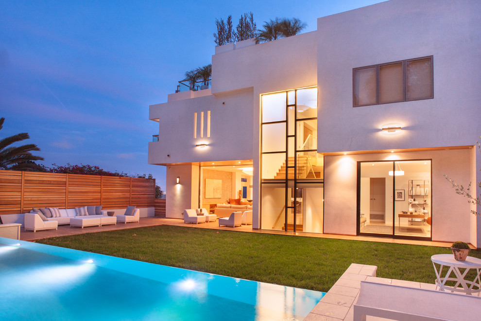 Inspiration for a huge contemporary white three-story stucco flat roof remodel in Los Angeles