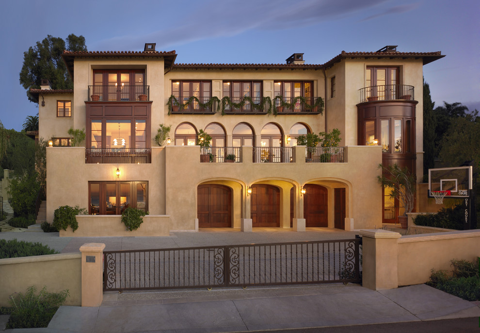 Example of a tuscan three-story exterior home design in Los Angeles