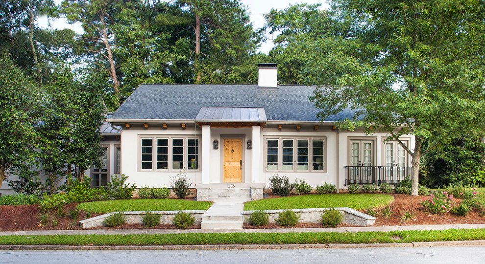 Mid-sized transitional white one-story stucco exterior home idea in Atlanta with a mixed material roof