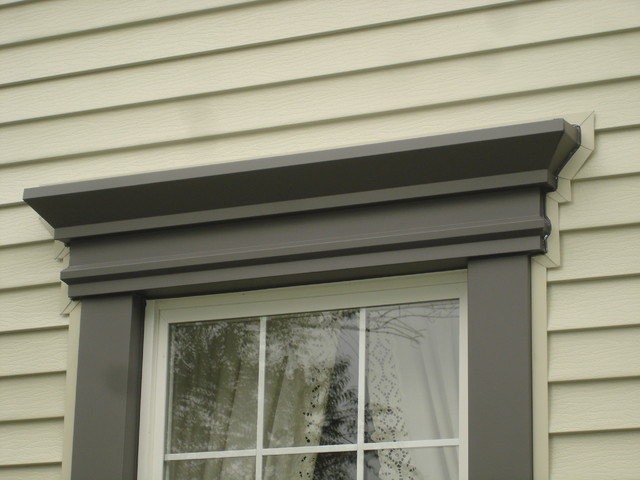 Window header detail traditional exterior cleveland for Decorative window trim exterior