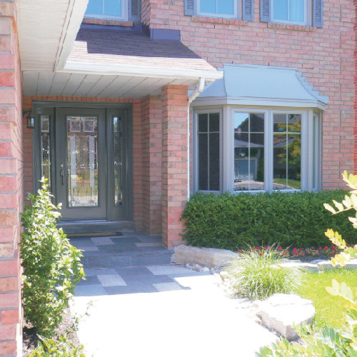 Windows and Front Single Door with Sidelights traditional-exterior