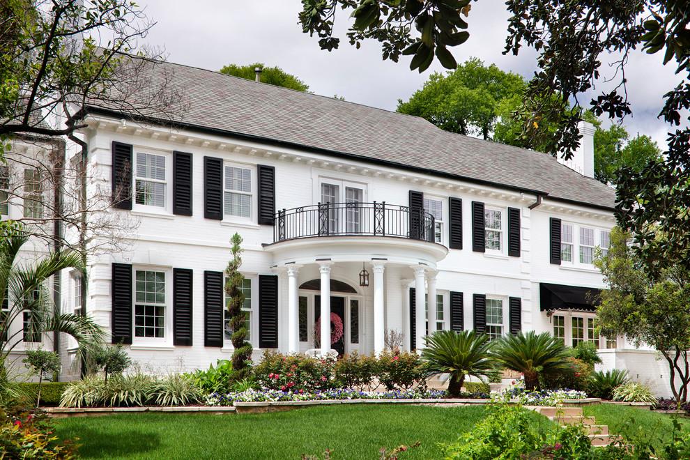 Elegant white two-story exterior home photo in Austin