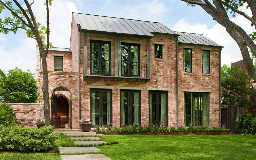 Inspiration for a transitional two-story brick exterior home remodel in Dallas
