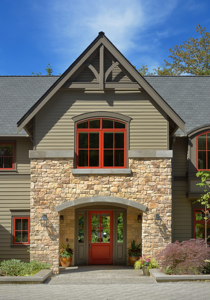 Transitional stone gable roof idea in Seattle