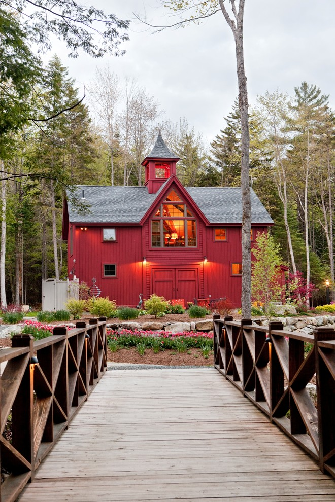 Large cottage red two-story wood exterior home photo in Manchester with a shingle roof