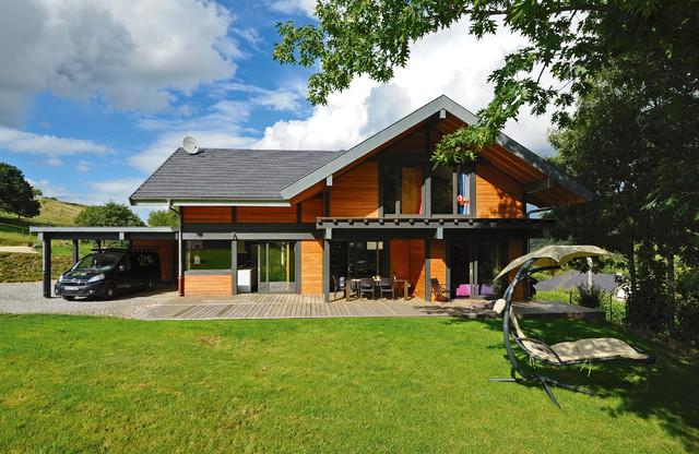 Maison bois poteau poutre barberaz savoie 7 contemporain for Facade maison en bois