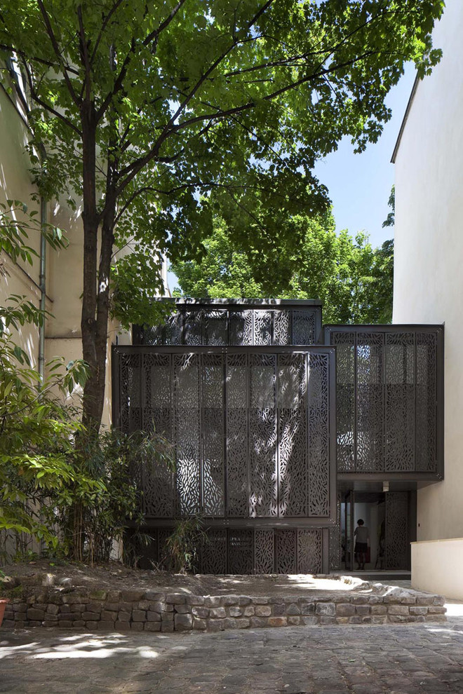 Inspiration for a mid-sized contemporary gray two-story metal flat roof remodel in Other
