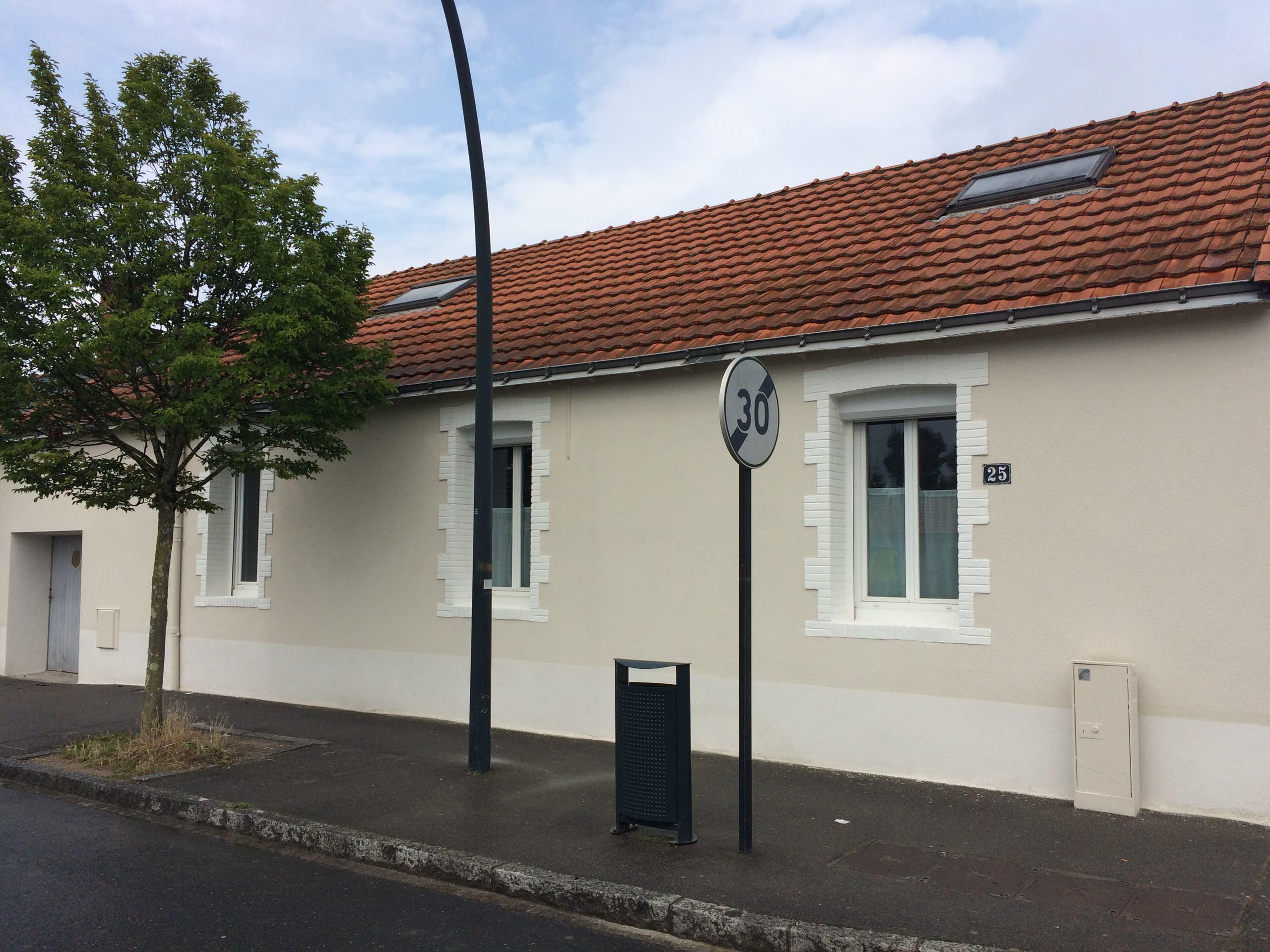 Rénovation de façade d'une ancienne maison ouvrière