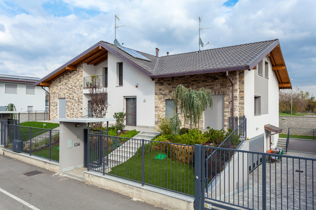 Ville unifamiliari e bifamiliari in campagna facciata for Piani di garage di campagna