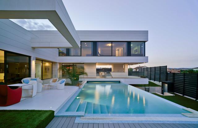 Vivienda unifamiliar moderno fachada otras zonas for Fachadas de viviendas