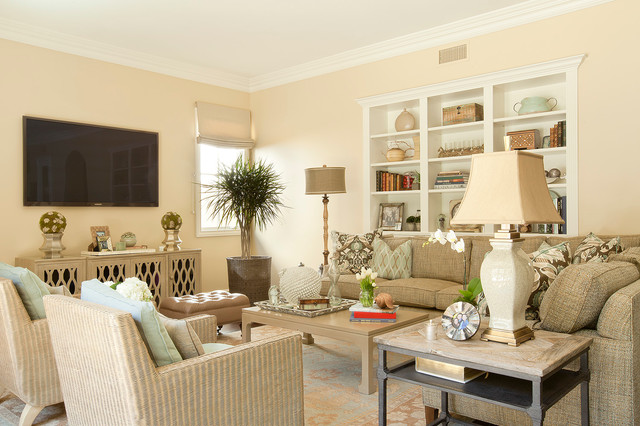 Family room - traditional family room idea in Los Angeles with beige walls and a wall-mounted tv