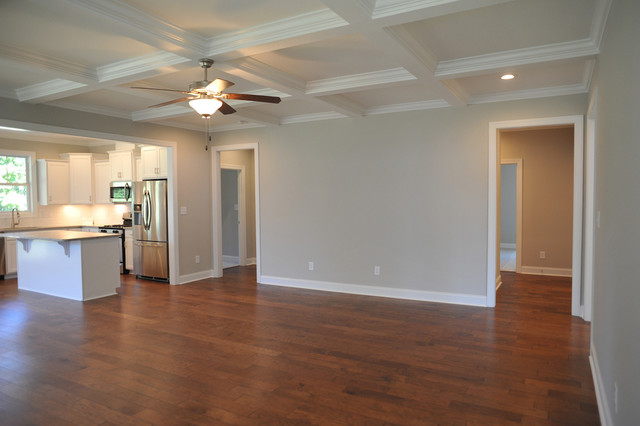 Coastal open concept medium tone wood floor family room photo in Other with gray walls, a standard fireplace and a wood fireplace surround