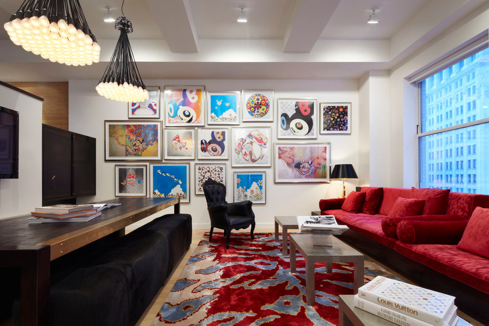 Trendy light wood floor family room photo in New York with white walls and a wall-mounted tv