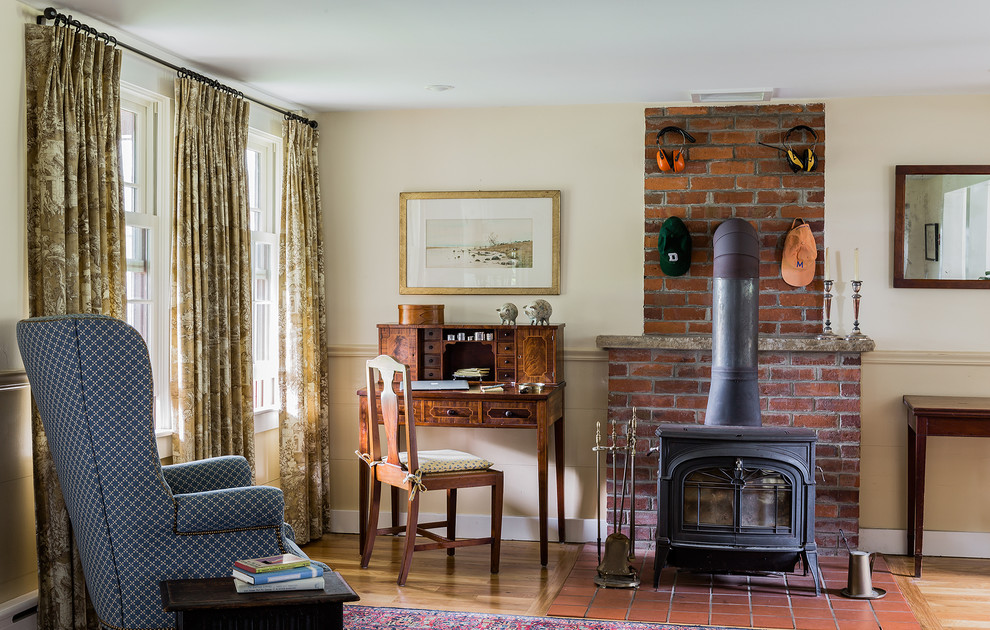 Example of a small classic family room design in Boston with a brick fireplace