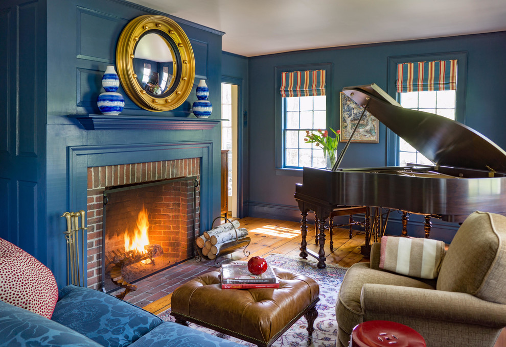 Elegant medium tone wood floor family room photo in Boston with a music area, blue walls, a standard fireplace and a brick fireplace