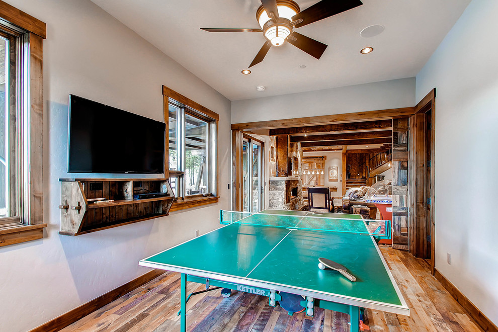 Example of a transitional open concept dark wood floor game room design in Denver with beige walls