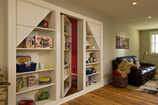 Example of a mountain style medium tone wood floor family room design in New York with beige walls
