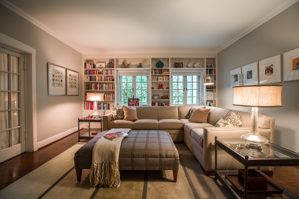 Family room library - mid-sized traditional enclosed dark wood floor family room library idea in St Louis with gray walls
