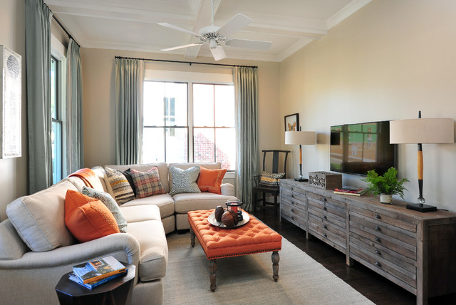 Inspiration for a small transitional enclosed medium tone wood floor family room remodel in Atlanta with beige walls and a wall-mounted tv