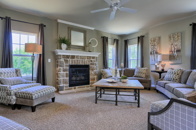 Inspiration for a mid-sized timeless open concept carpeted family room remodel in Other with beige walls, a standard fireplace, a stone fireplace and no tv