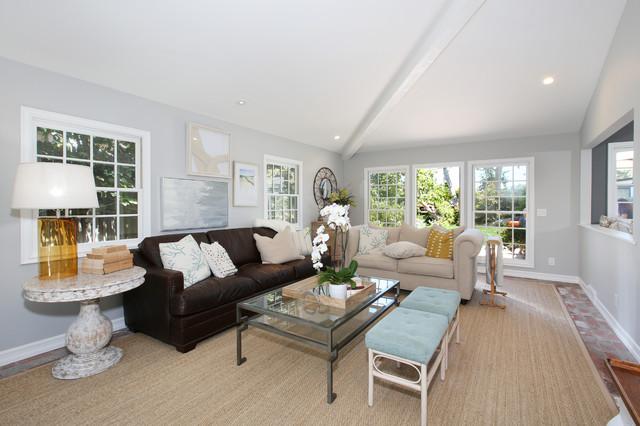 Coastal brick floor family room photo in Orange County with gray walls