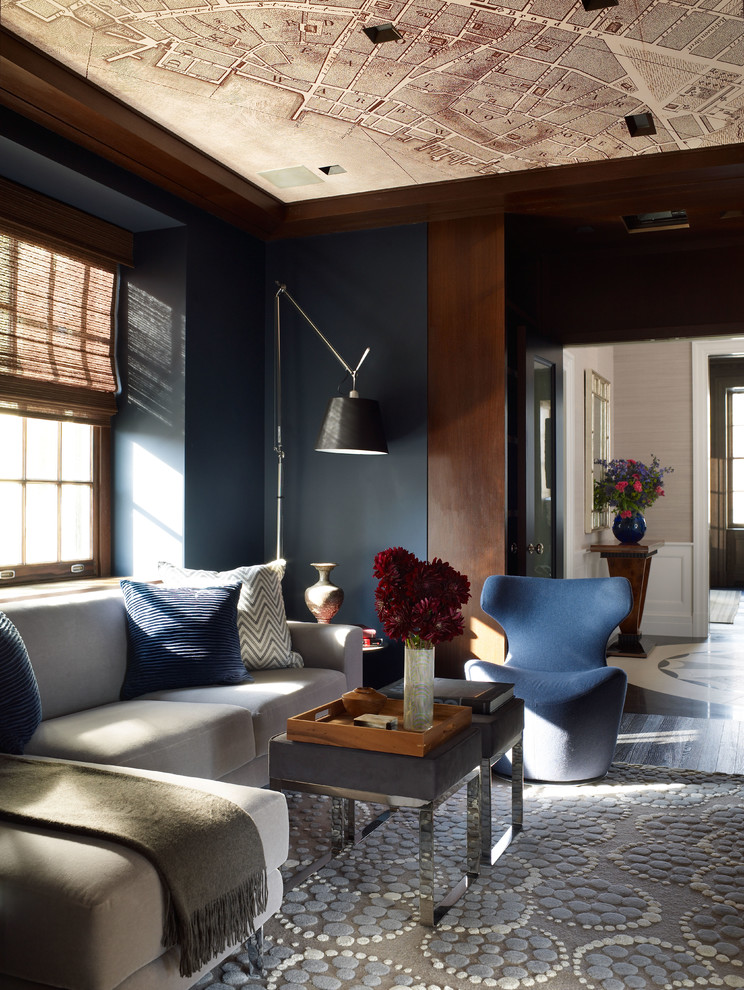 Inspiration for a transitional enclosed family room remodel in New York with blue walls