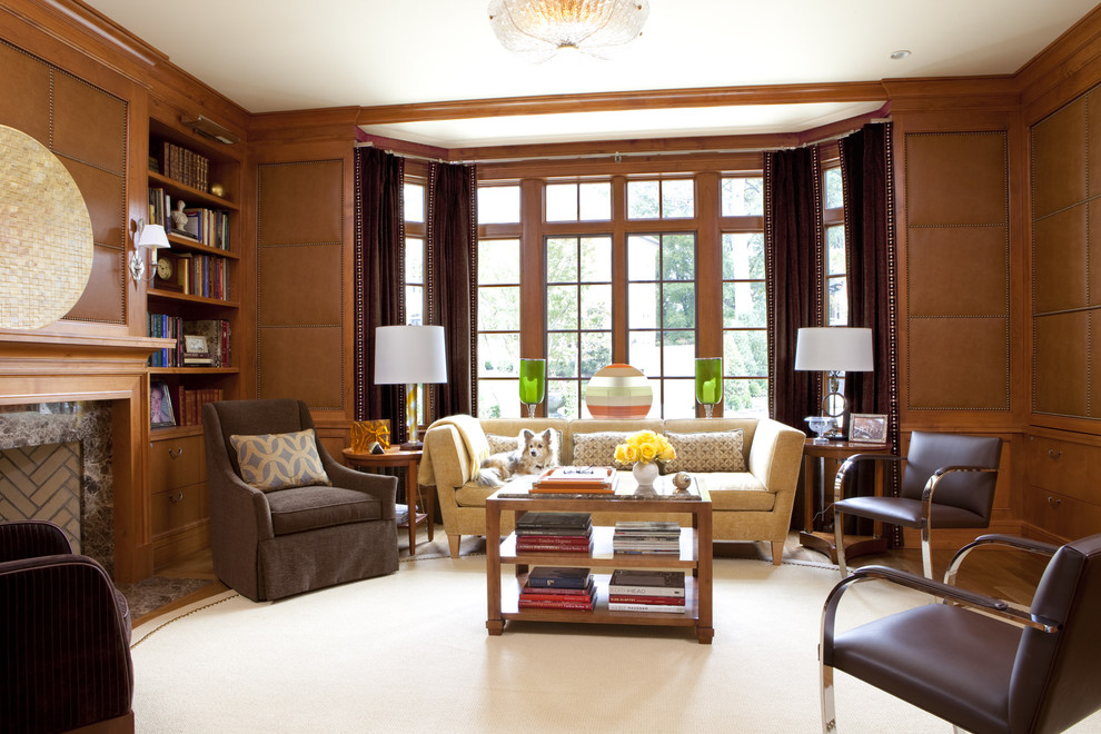 Example of a trendy medium tone wood floor family room design in DC Metro with brown walls, a standard fireplace and a stone fireplace