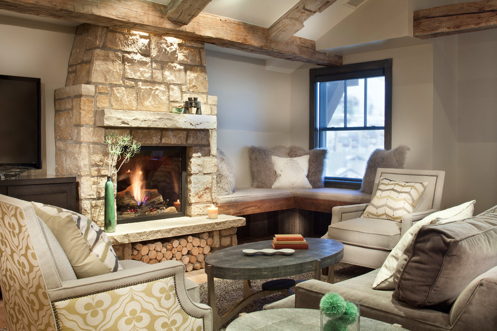 Small mountain style family room photo in Denver with a standard fireplace and a stone fireplace