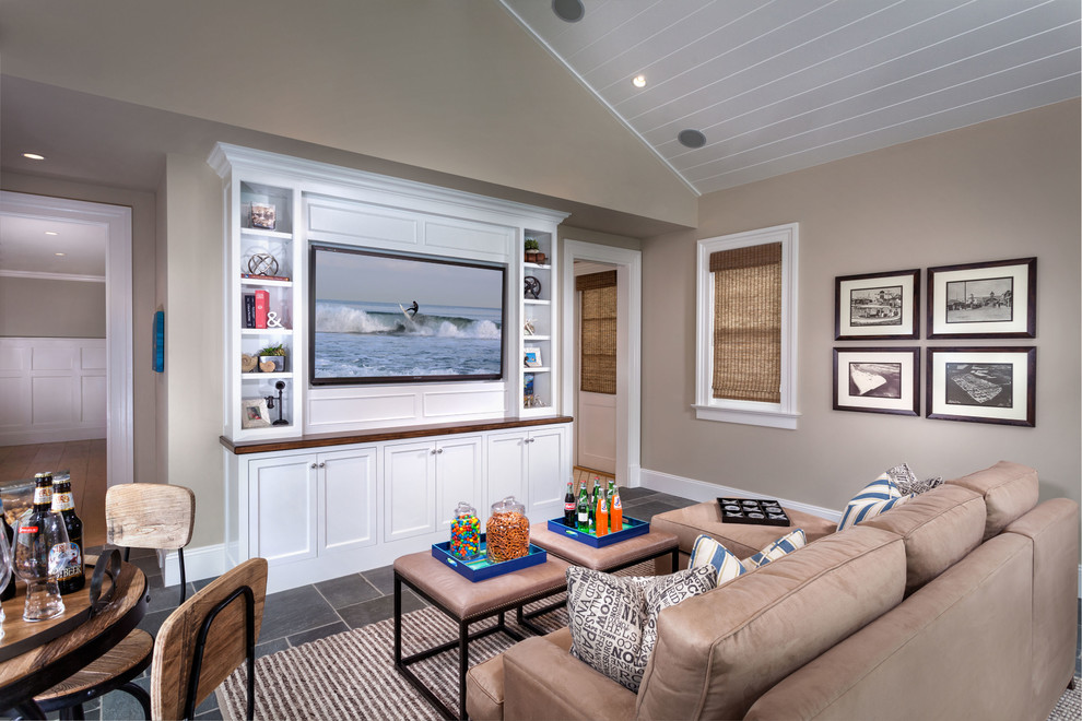 Beach style family room photo in Orange County with beige walls and a media wall