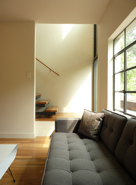 A Parallel Architecture midcentury-family-room