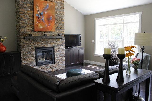 a rustic fireplace is the focal point in this cozy living room transitional family room