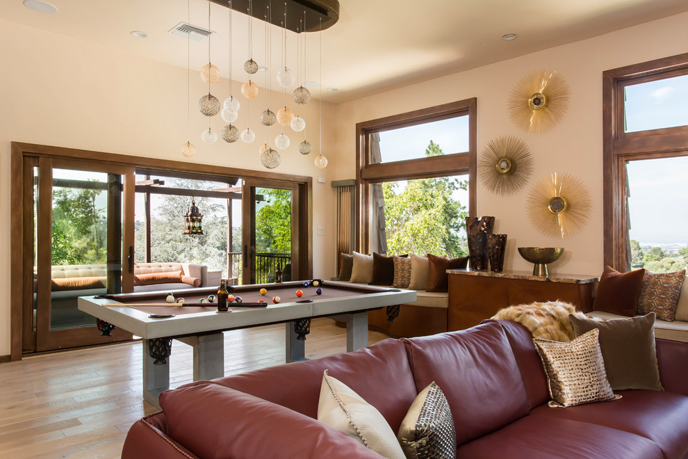 Example of a huge eclectic loft-style light wood floor family room design in Los Angeles with beige walls, a standard fireplace and a tile fireplace