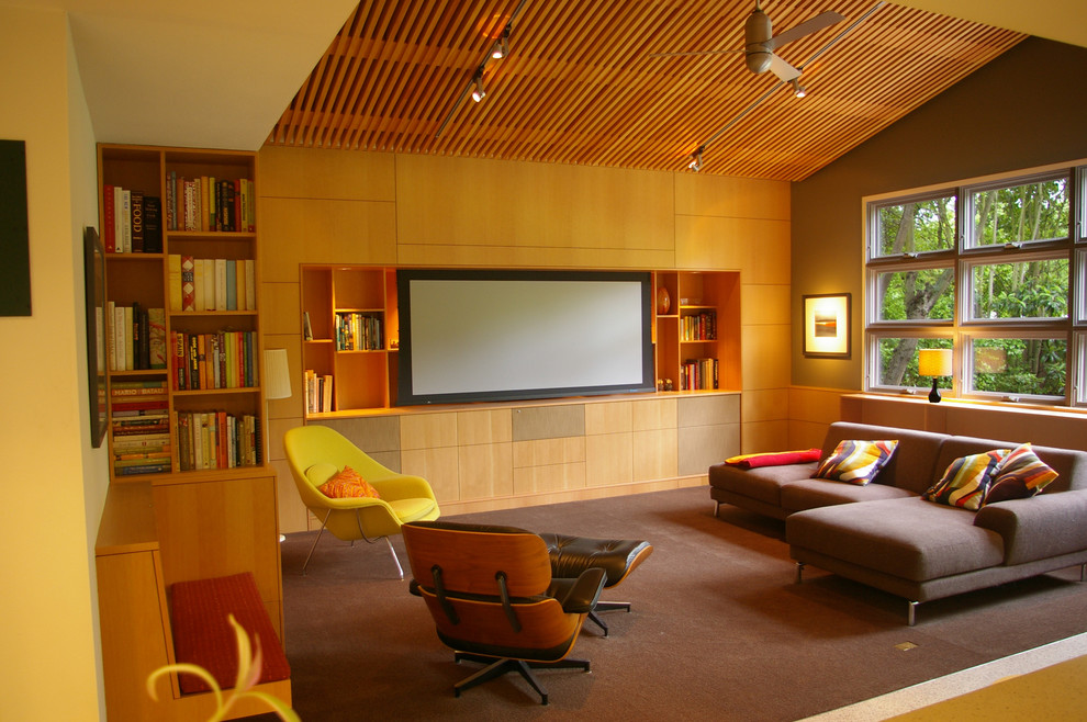 1950s carpeted family room photo in San Francisco with green walls and a media wall