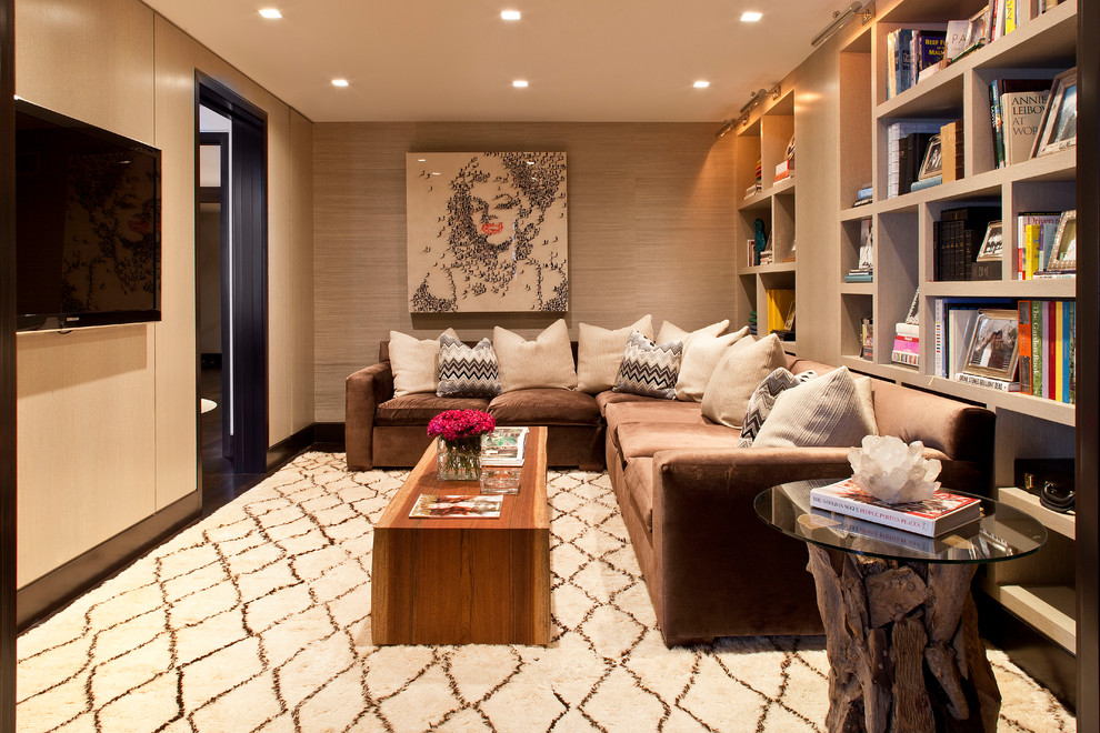 Family room - contemporary enclosed carpeted family room idea in New York with brown walls and a wall-mounted tv