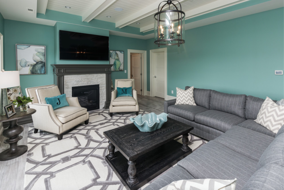 Inspiration for a large modern open concept painted wood floor family room remodel in Other with blue walls, a standard fireplace, a stone fireplace and a wall-mounted tv