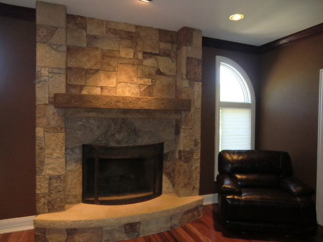 Ann Art Faux Finishes / Cement fireplace over white brick family-room
