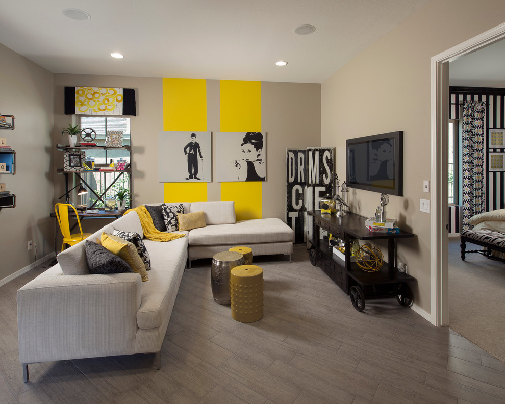 Inspiration for a contemporary family room remodel in Phoenix with yellow walls, no fireplace and a wall-mounted tv