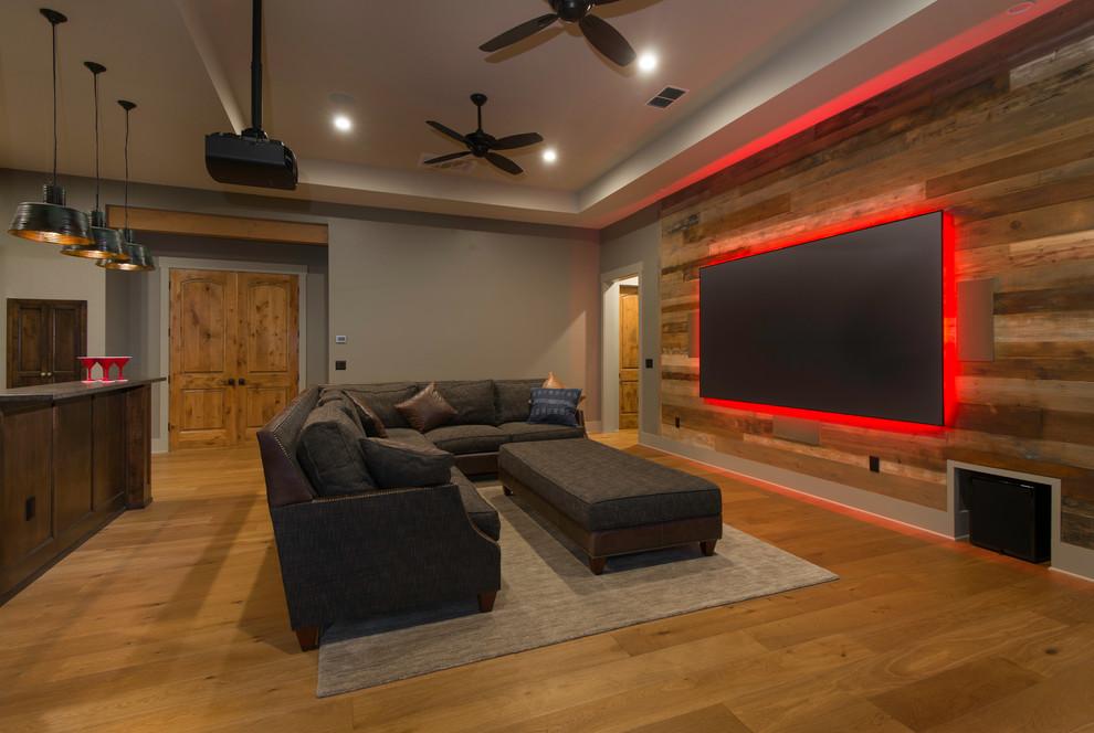 Ispirazione per un soggiorno stile rurale aperto con pareti grigie, pavimento in legno massello medio e pavimento marrone