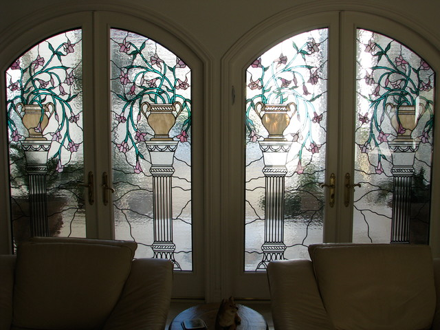 Arched French Doors With Stained And Leaded Glass Inserts